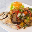 Spicy sea bass fried with black pepper on white plate — Stock Photo #41777667