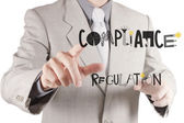 Businessman hand pointing to Compliance Regulation designwords a — Stock Photo