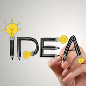 Close up of hand writing idea design light bulb as concept — Stock Photo