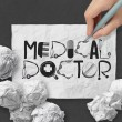 Stock Photo: Hand drawn design word MEDICAL DOCTOR on crumpled paper with as