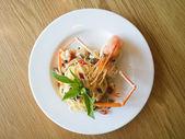 Italian spaghetti pasta and fresh spicy shrimps sauce on wooden  — Stock Photo