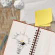 Note book with hand drawn light bulb and THINK word design as c — Stock Photo