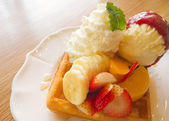 Waffle with fruits on wooden table — Stock Photo
