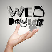 Clouse up of  hand showing design word WEB DESIGN  as concept — Stock Photo