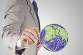 Businessman hand drawing abstract globe as concept  — Stock Photo