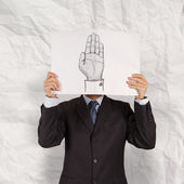 Businessman show book of  Hand raised and crumpled paper backgro — Stock Photo