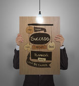 Man showing poster of hand drawn SUCCESS business diagram on woo — Stockfoto