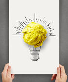 Hand drawn light bulb with crumpled paper ball on paper poster a — Stock Photo