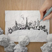 Crumpled paper with hand drawn traveling around the world on woo — Stock fotografie