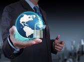 Businessman hand show 3d world  with padlock as Internet securit — Stockfoto
