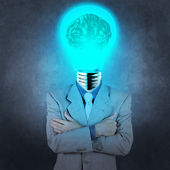 Businessman with lamp-head 3d metal brain as concept — Stock Photo