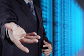 Businessman hand and server room background as concept  — Stock Photo