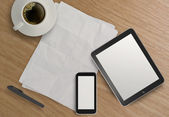 3d empty tablet with mobile phone and a cup of coffee on the woo — Foto Stock