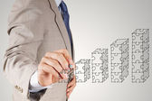 Businessman hand puzzle charts with new modern computer and busi — Foto Stock
