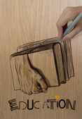 Hand drawn of hands holding the books on wood background as crea — Stock Photo