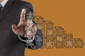Businessman hand puzzle charts with new modern computer and busi — Stock Photo