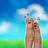 The happy finger couple in love with painted smiley and sing a s — Stock Photo