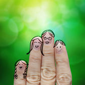 Happy finger family on green nature background  — Stock Photo