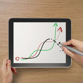 Hand with stylus and eraser deleting falling graph business as c — Stock Photo
