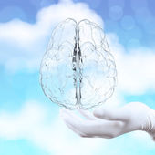 Medical doctor hand showing 3d glass human brain on nature backg — Stock Photo