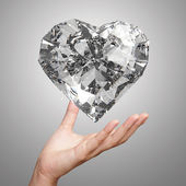 Hand holding 3d diamond heart shape as concept — Stock Photo