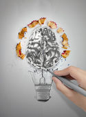 Hand drawn light bulb with pencil saw dust and 3d brain on paper — 图库照片