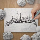 Crumpled paper with hand drawn traveling around the world on woo — Stockfoto