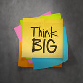 Hand drawn Think BIG phrase on sticky note texture background as — Stock Photo