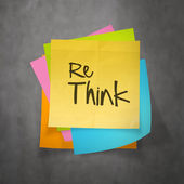 Hand drawn  RETHINK word paper sticky note on texture background — Stock Photo