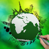 Hand drawn traveling around the world on green nature background — Stock Photo