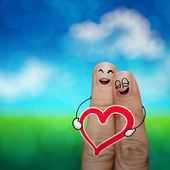 The happy finger couple in love with painted smiley and hold hea — Stock Photo