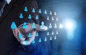 Affärsman hand välja människor ikonen som begrepp som mänskliga resurser — Stockfoto