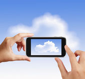 Smart hand using touch screen phone take photo of cloud icon as  — Stock Photo