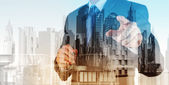 Double exposure of businessman and abstract city  — Stock Photo