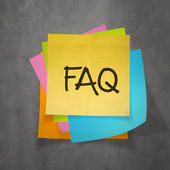 """faq"" text on sticky note paper on wall texture — Stock Photo"
