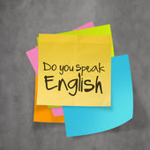 """do you speak english"" text on sticky note paper on wall texture — 图库照片"