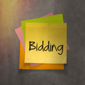"""bidding"" text on sticky note paper on wall texture — Stock Photo"