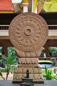 Buddha pray wheel with snake statue — Stock Photo