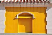 White brick frame with yellow wall European style — Stock Photo