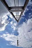 Crain with iron pendulum hook with blue sky — Stock Photo