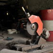 Stock Photo: Cutting grinder and old exhaust pipe