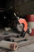 Cutting grinder and old exhaust pipe — Stock Photo