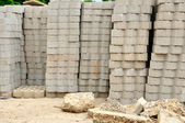 Piles of bricks and gravel in a construction site — Stock Photo