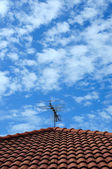 Red roof with sky and clouds — Stock Photo
