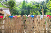 Bamboo fence to be cloth line in local village, North Thailand. — Stock fotografie
