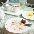Soiled cake plates on rattan table — Stock Photo