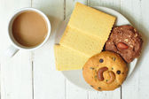 Crackers, cookies on plate with coffee — Stock Photo