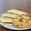 Crackers and cookies on plate. — Stock Photo