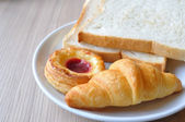 Breads and Croissants on breakfast table. — Stock Photo