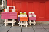 Colorful wooden tables and chairs — Foto de Stock